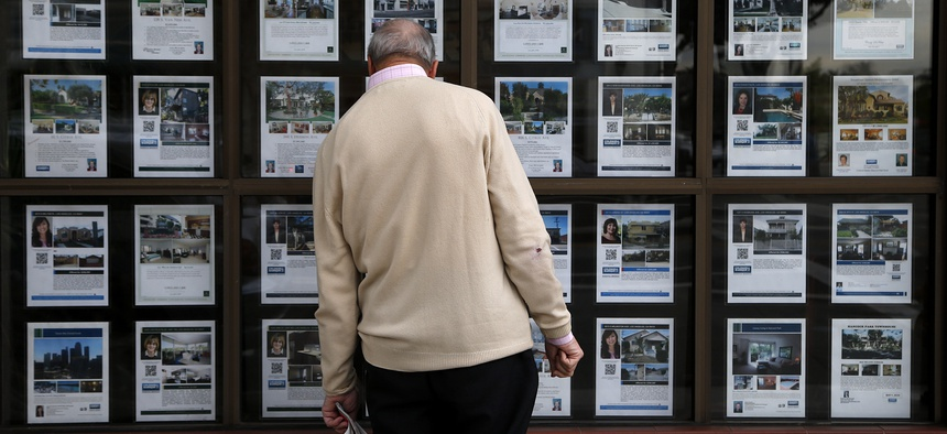 A man looks at listings of homes for sale in Los Angeles.