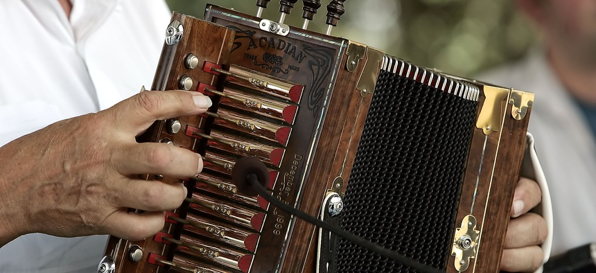 The experienced fingers of Marc Savoy, find their keys on the melodeon or cajun accordian at the at the Festivals Acadiens in Lafayette, La.