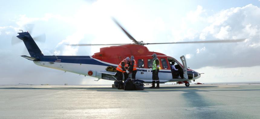 An air ambulance loads before take off.