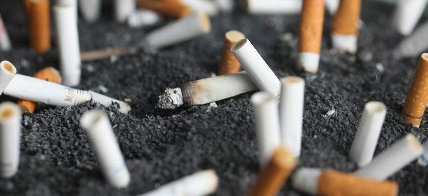This March 28, 2019, photo shows cigarette butts in an ashtray in New York