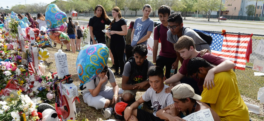Students at a vigil for the Parkland school shooting in 2018. Florida passed a red flag law after the shooting, after many debated the mental health of the shooter.