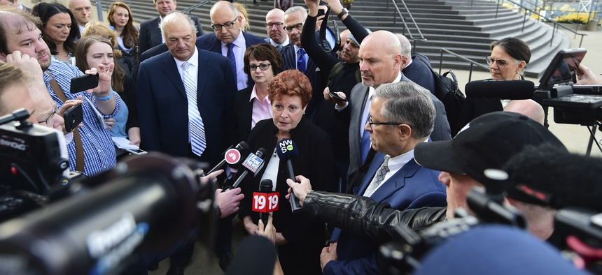Summit county executive Ilene Shapiro speaks to the media outside the U.S. Federal courthouse, Monday, Oct. 21, 2019, in Cleveland about a $260 million settlement agreement with drug companies.