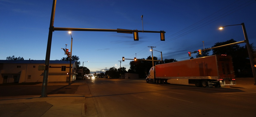 In this photo taken Oct. 16, 2014, dusk descends over the small rural town of Yuma, eastern Colorado. This farming hamlet of 3,200 near the Nebraska border is home to an increasing number of Latino immigrants.