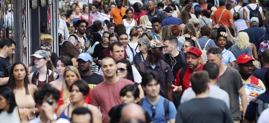 In this Aug. 22, 2019, photo, people walk through New York's Times Square. With just a few months left before America starts taking its biggest-ever self-portrait, the U.S. Census Bureau is grappling with a host of concerns about the headcount.