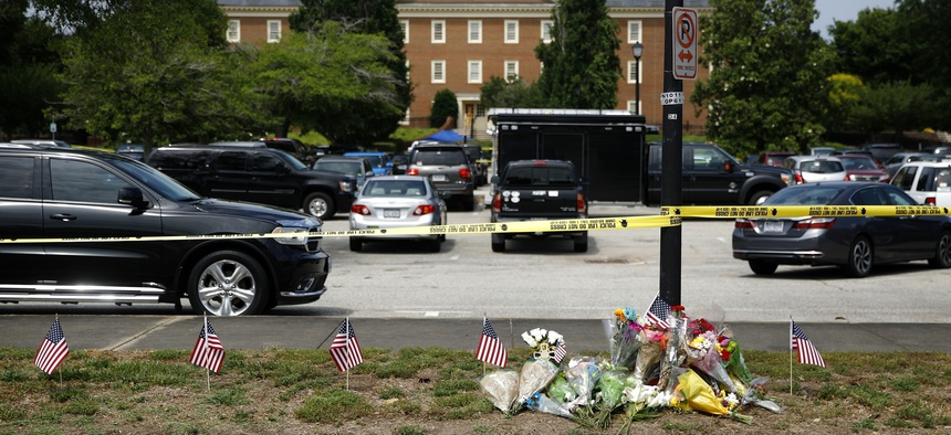 The day after a mass shooting in Virginia Beach, Virginia, a makeshift memorial was created at the edge of a police cordon in front of a municipal building.