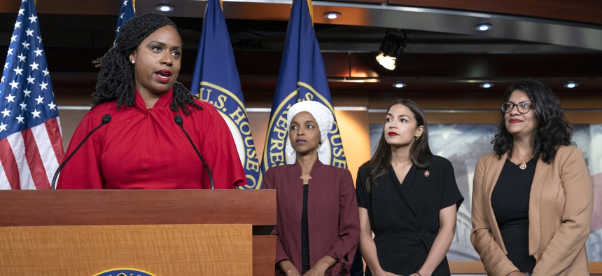 """Rep. Ayanna Pressley speaks at a press conference with the other members of """"The Squad,"""" Reps. Ilhan Omar, Alexandria Ocasio-Cortez, Rashida Tlaib."""