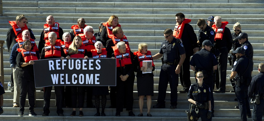 Faith leader were arrested during a protest in support of the refugee resettlement program in Oct. 2019. Faith groups are suing the Trump administration over changes to the refugee resettlement system.