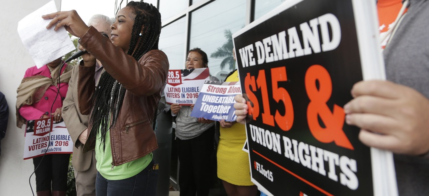 Protestors in Florida call for a higher minimum wage and other legislation during 2016 in Florida. The state is one of about two dozen around the U.S. that have statutes restricting local minimum wage laws.