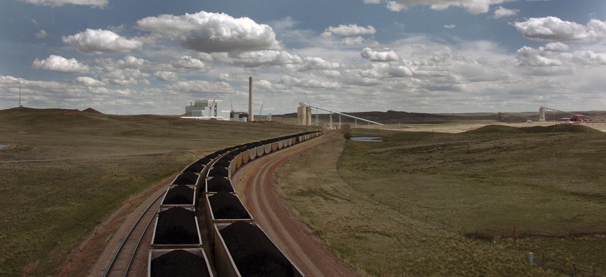 A pair of coal trains idle near Gillette, Wyo. in 2010. Slack demand for coal in the U.S. in recent years has caused mines to look abroad for potential customers.