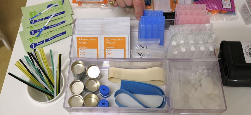Safe injection supplies like the ones shown here include gauze, needles, tourniquets, and alcohol swabs.