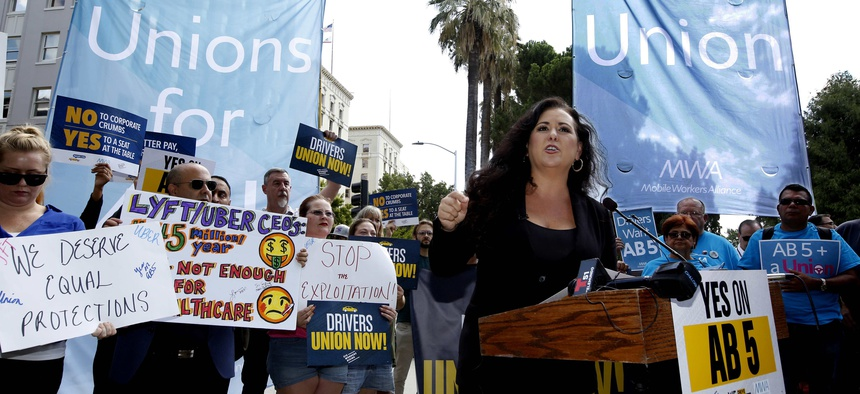 In this Aug. 28, 2019, file photo, Assemblywoman Lorena Gonzalez, D-San Diego, speaks at rally calling for passage of her measure to limit when companies can label workers as independent contractors at the Capitol in Sacramento, Calif.