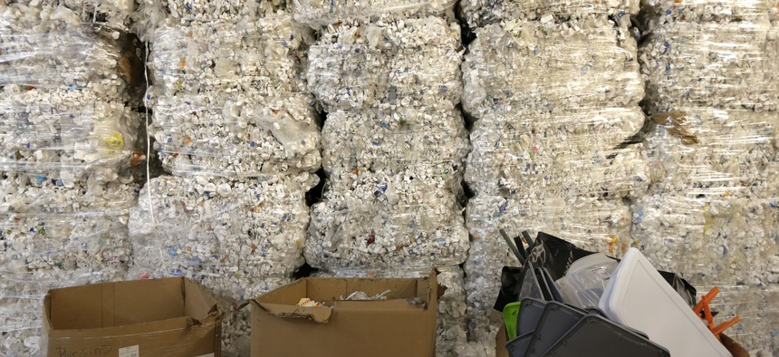 In this May 7, 2019 photo, plastic pill bottles are bundled for recycling at a GDB International warehouse in Monmouth Junction, N.J.