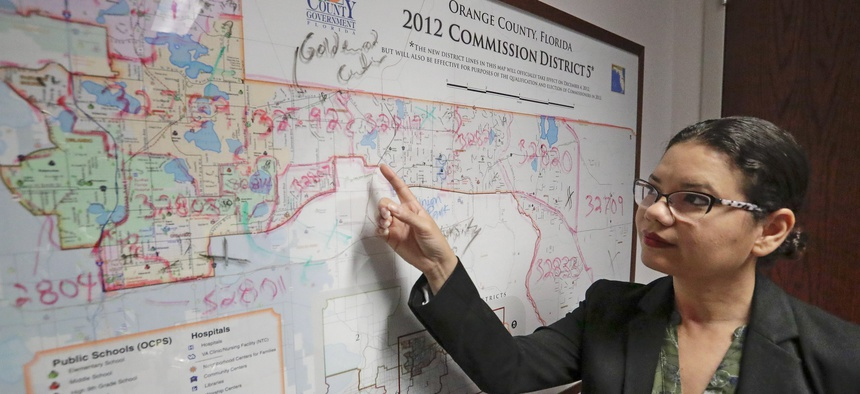 County Commissioner Emily Bonilla of Orange County, Florida, shows a map of her district. The Democrat fears an undercount in this year's census. Florida is among the red states now pushing to boost participation.