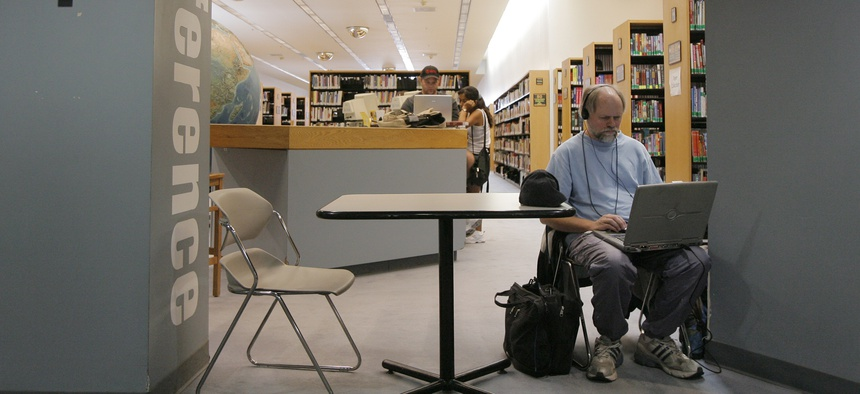Jeff Quitney, 50, surfs the internet using free Wi-Fi service at the Las Vegas Library in Las Vegas, Monday, Sept. 10, 2007.