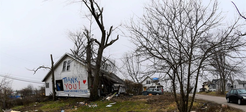 A thank-you message to volunteers on a heavily damaged home in suburban Dayton, Ohio's Northridge community.