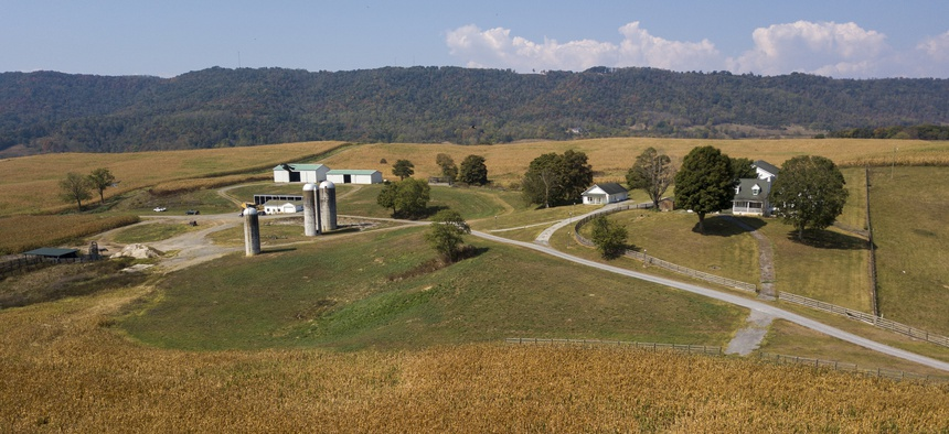 This Oct. 1, 2019 aerial photo shows farm buildings and a farm house surrounded by a crop of corn on a farm owned by the family of West Virginia Governor Jim Justice near Lewisburg, W.Va.