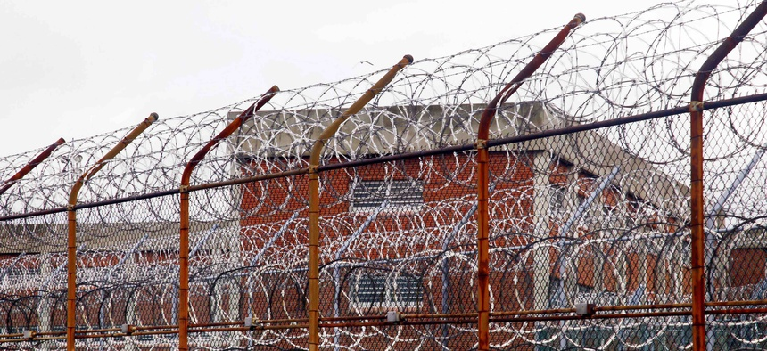 In this 2011, file photo, a fence surrounds housing on the Rikers Island correctional facility in New York. The city's jail system has cases of the coronavirus. Neighboring New Jersey is moving ahead with an inmate release plan.