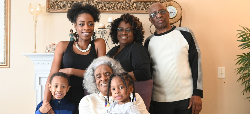 """The Walker family ― (standing from left) Michael """"Amir"""" Nimrod, Andre'a Walker-Nimrod, Wilma Walker, Howard Walker, (seated) matriarch Evelyn Whitfield and Maleeya Nimrod―all live together in Florissant, Missouri."""
