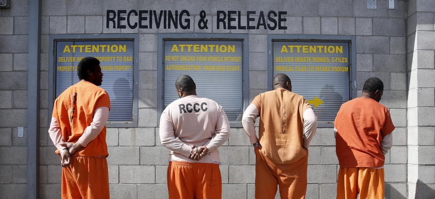 People wait to be processed in a California correctional facility. California changed its bail schedule with the intention of releasing more people from jails and slowing the spread of coronavirus in correctional facilities.