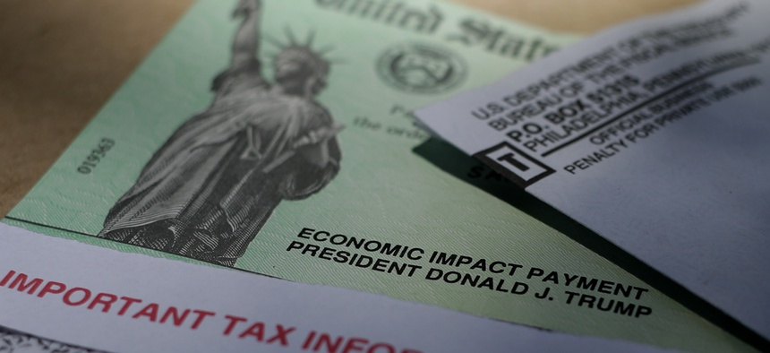 President Donald J.Trump's name is printed on a stimulus check issued by the IRS to help combat the adverse economic effects of the COVID-19 outbreak, Thursday, April 23, 2020, in San Antonio.