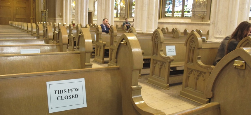 Half of the pews were closed to congregants as services resumed at the Cathedral of St. Helena in Helena, Mont., Sunday, April 26, 2020.
