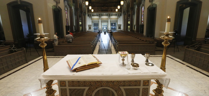 The Altar is prepped for a live streamed mass that Bishop Barry C. Knestout will conduct in an empty sanctuary at the Cathedral of the Sacred Heart Sunday April 12, 2020, in Richmond, Va., due to COVID-19.