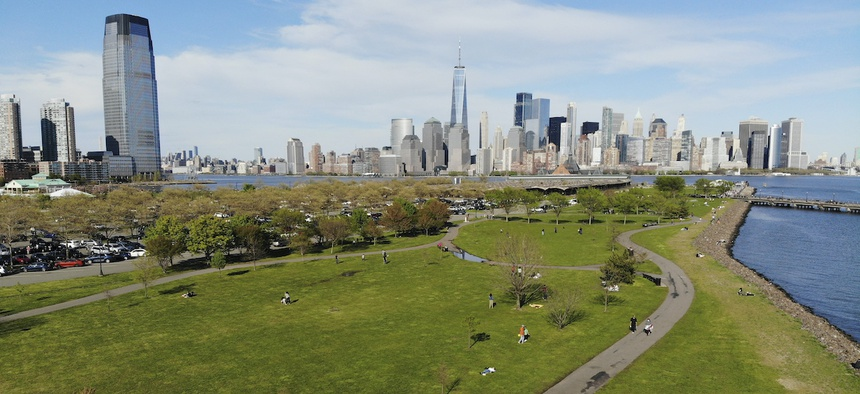 "People enjoy the good weather while keeping their distance from one another at Liberty State Park in Jersey City, N.J., Saturday, May 2, 2020. Gov. Phil Murphy said early reports of behavior at the state's newly reopened parks were ""so far, so good."""