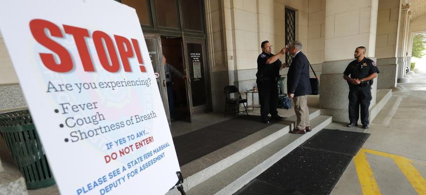 A legislator has his temperature taken outside the State Capitol in Baton Rouge, Louisiana.