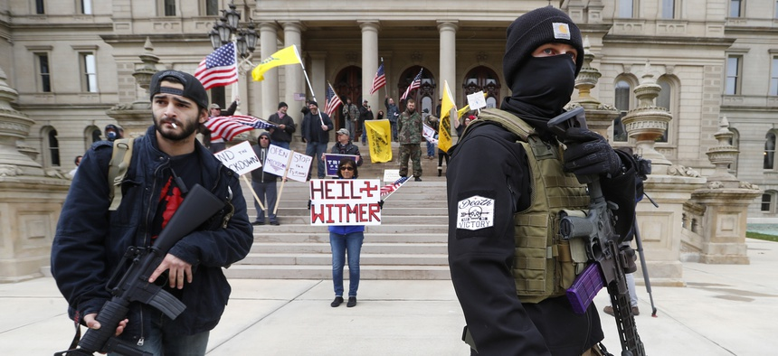 Protesters at the Michigan State Capitol in Lansing. The protests in the state have been organized in part by state militia groups.