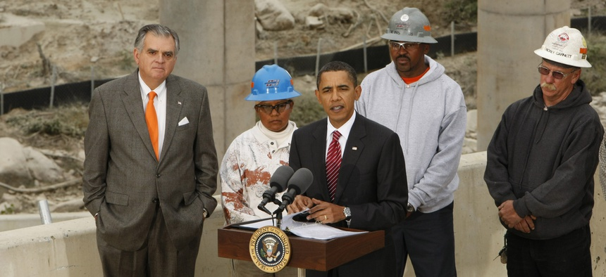 Former President Barack Obama makes remarks about the Recovery Act during a tour of the the Fairfax County Parkway extension project in Springfield, Va. on Oct. 14, 2009. Former Transportation Secretary Ray LaHood is at left.