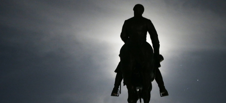 The moon illuminates the statue of Confederate General Robert E. Lee on Monument Avenue in Richmond, Va. Virginia Gov. Ralph Northam has ordered the removal of the statue.