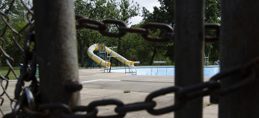 An empty municipal swimming pool is seen at Jordan Park in Allentown, Pa., Friday, May 29, 2020.