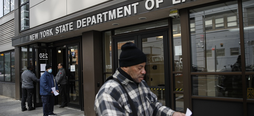 In this March 18, 2020 file photo, visitors to the Department of Labor are turned away at the door by personnel due to closures over coronavirus concerns in New York.