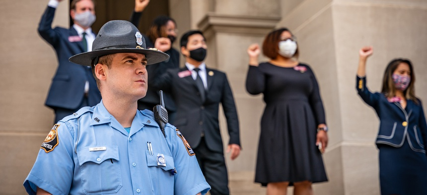 A member of law enforcement outside the Georgia State Capitol during a recent protest organized by the NAACP.