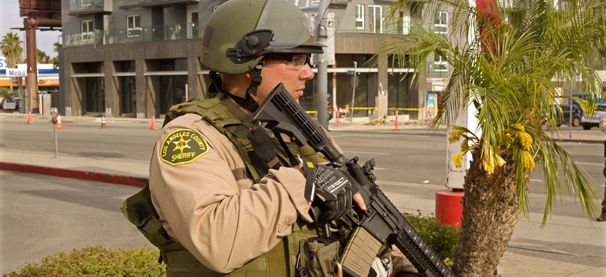 A Los Angeles County police officer holds a rifle at a recent protest.
