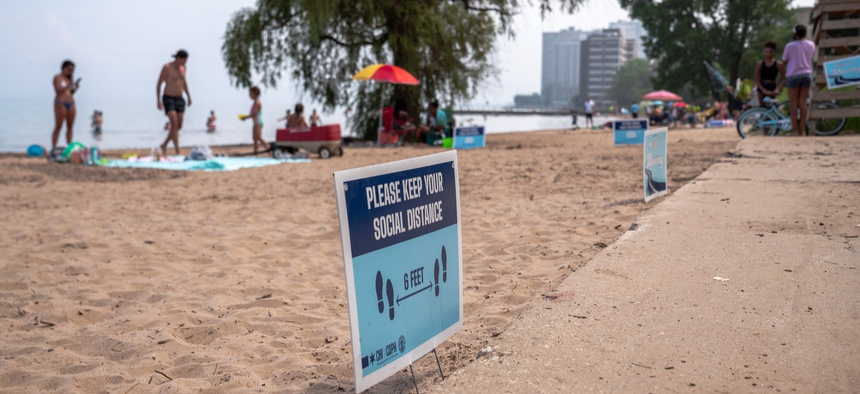 A sign reminds beachgoers in Chicago to social distance.