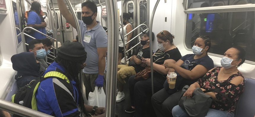 Riders wear masks on a New York City subway train on July 22, 2020.