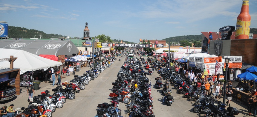 In this Aug. 5, 2015, file photo, motorcycles stretch down Main Street in Sturgis, S.D., for the landmark Sturgis Motorcycle Rally. About 250,000 people are expected for this year's event, which is proceeding despite local concerns about Covid-19.