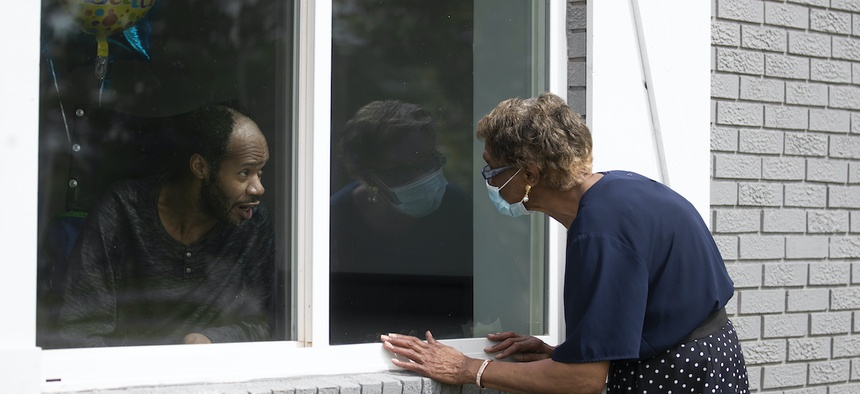 Southern Pines nursing home resident Wayne Swint gets a birthday visit from his mother, Clemittee Swint, in Warner Robins, Ga. in June. Staff members at facilities across the country are arranging window visits as face-to-face visits remain off-limits.