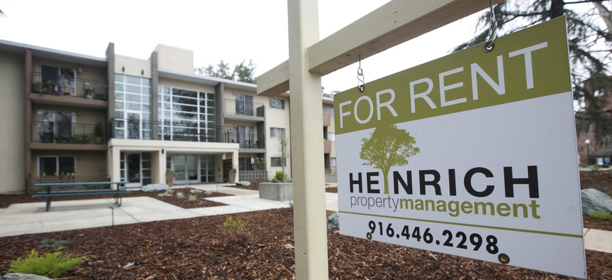 """In this Jan. 2018 file photo """"For Rent"""" sign is posted outside an apartment building in Sacramento, Calif."""