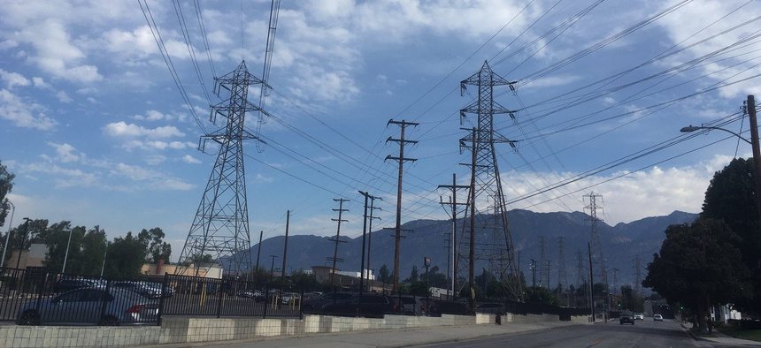 Electrical grid transmission towers are seen in Pasadena, Calif., Saturday, Aug. 15, 2020. The operator of the state's power grid declared an emergency Friday evening, Aug. 14, and ordered utilities to shed their power loads.