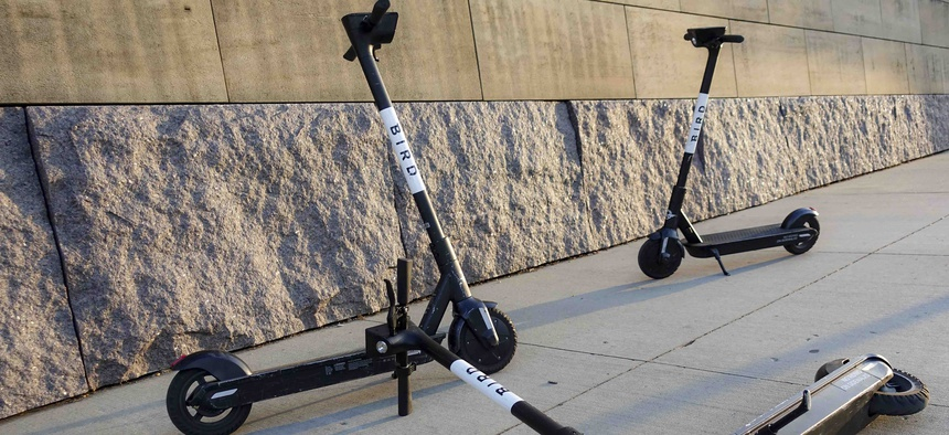 Sharable electric scooters by Bird Rides, Inc. wait on downtown sidewalks for pedestrian use, Wednesday, Oct. 2, 2019, in downtown Cincinnati.