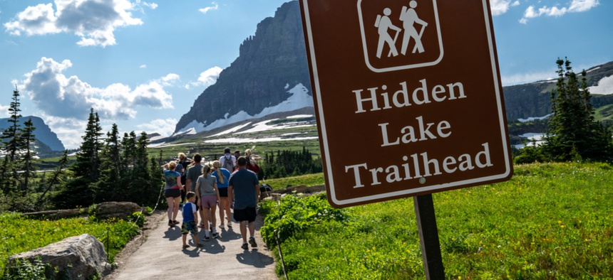 A crowded trailhead at Glacier National Park.