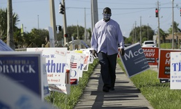 William Freeman, a formerly incarcerated person who registered to vote recently, walks outside his polling station in Riviera Beach, Florida. Efforts to raise money so that people with criminal records in the state can vote have raised millions.