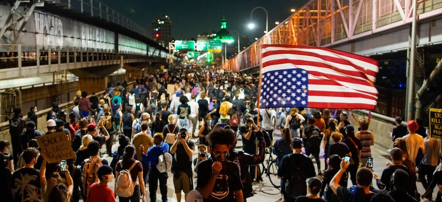 Demonstrators march on the Williamsburg Bridge during a protest, Wednesday, Sept. 23, 2020, in New York, following a Kentucky grand jury's decision not to indict any police officers for the killing of Breonna Taylor. (AP Photo/Eduardo Munoz Alvarez)