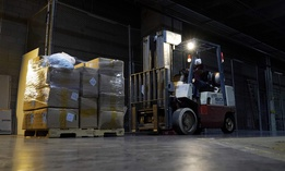 A worker with a forklift picks up a pallet of protective gear in Phoenix in early September, 2020. Personal protective equipment is one cost localities have been covering with federal aid.
