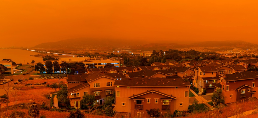 Thick orange haze above San Francisco in early September from record wildfires in California. States should partner with the insurance industry to address climate change and the associated effects.