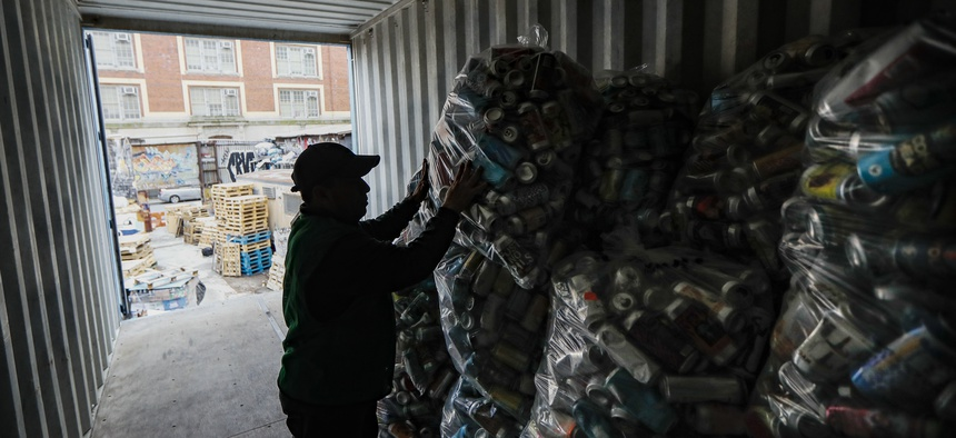 Manuel Rene Del Carmen organizes bags of recyclables on a roof at the Sure We Can, a Brooklyn non-profit redemption center Thursday, Feb. 27, 2020, in New York.
