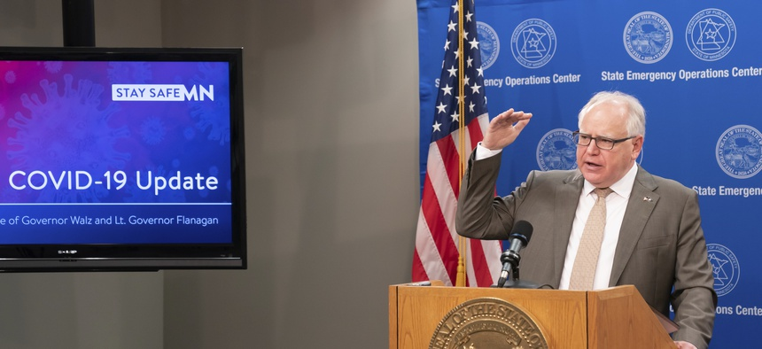 Minnesota Gov. Tim Walz at a briefing in May. Minnesota's coronavirus data dashboard is a model for how states can better use data in the pandemic and beyond.