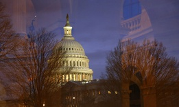 Light illuminates the U.S. Capitol dome as it is seen though window reflections in Washington, Monday, Jan. 27, 2020.